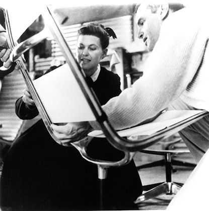 Charles and Ray Eames working on prototype